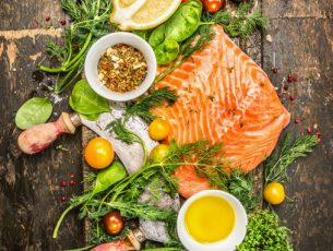 Salmon fillet with fresh healthy herbs,vegetables, oil and spices